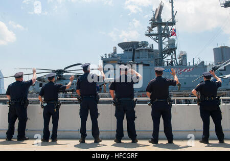 160531-N-WE887-045 NEW YORK (May 31, 2016) New York City Police officers way goodbye to USS Bataan (LHD 5) Sailors - Stock Photo