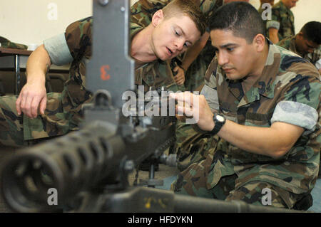 040517-N-3750S-002 Port Hueneme, Calif. (May 17, 2004) - Utilitiesman 2nd Class Shane Pillsbury, left, gives Equipment - Stock Photo