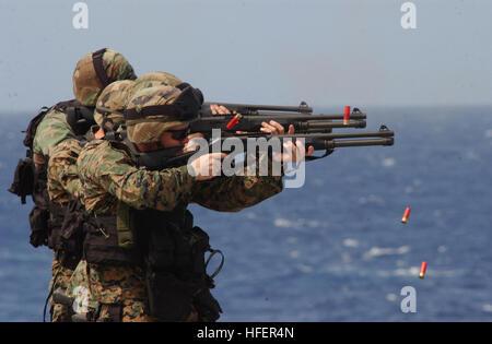 031106-N-1693W-002 Aboard USS Blue Ridge (LCC 19) Nov. 6, 2003 -- Marines assigned to the 2nd Fleet Anti-Terrorism - Stock Photo