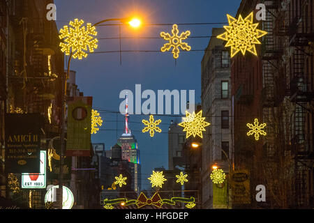 Empire State Build with Christmas lights as seen from Mulberry Street in New York's Little Italy - Stock Photo