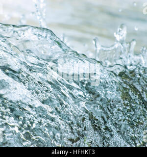 Water cascade waterfall streaming splashes background, large detailed closeup, bright blue, sea green pastel colors, - Stock Photo