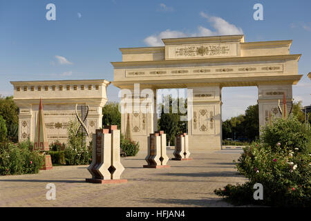 Ornate gates to Independence Park Shymkent Kazakhstan with granite steles with 20 years history 1991 to 2011 - Stock Photo