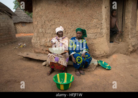 Koumban village, Guinea, 2nd May 2015; Sona Sacko, 75,  and her daughter Tenein Doumbouya, 35, are Shea butter sellers. - Stock Photo