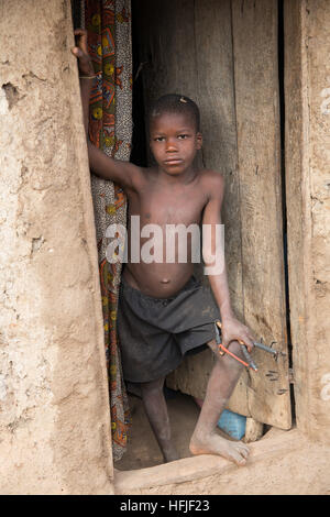 Koumban village, Guinea, 2nd May 2015; Son of Tenein Doumbouya, 35, a shea butter seller. - Stock Photo
