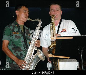 050622-N-7783B-007 Sattahip, Thailand (June 22, 2005) - Musician 3rd Class Jason Stark of the 7th Fleet Band, ÒOrient - Stock Photo