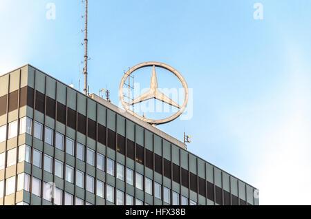 Mercedes-Benz logo on top of the high-rise tower at the Europa-Center. Breitscheidplatz, Berlin, Germany - Stock Photo