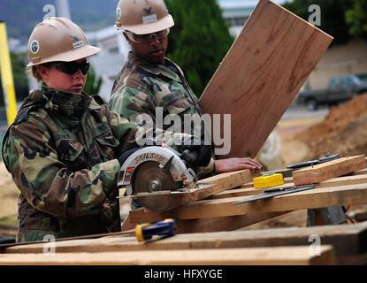 091217-N-0807W-127 SASEBO, Japan (Dec. 17, 2009) Utilitiesman Constructionman Kaytln Dobnick, assigned to Naval - Stock Photo