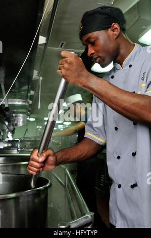 110608-N-AV746-077 ARABIAN SEA (June 8, 2011) Culinary Specialist 3rd Class Brad Weldon, from Cordele, Ga., stirs - Stock Photo