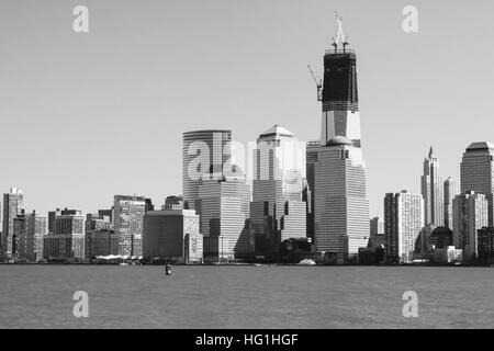 A view of Lower Manhattan in 2012 with the Freedom Tower under construction.  Photo taken in March, 2012. - Stock Photo