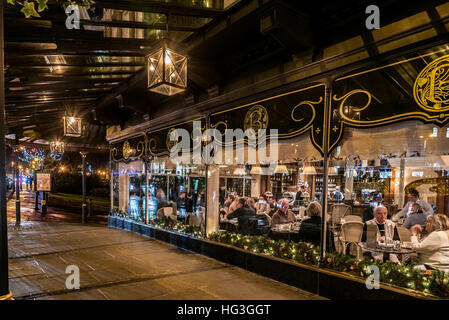 The Famous Betty's Tearooms in Harrogate North Yorkshire in the early evening with Christmas decorations. - Stock Photo