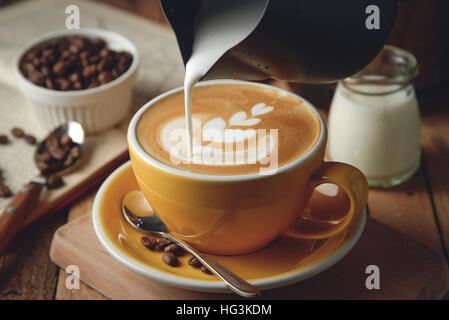 Making latte Art on a Cappuccino. Freshly made - Stock Photo