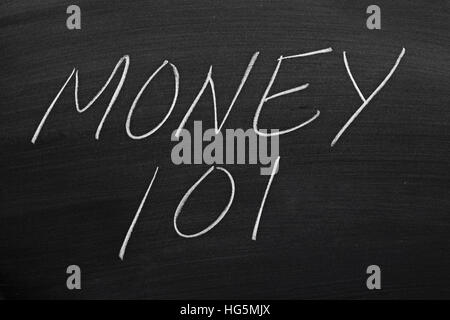 The words 'Money 101' on a blackboard in chalk - Stock Photo