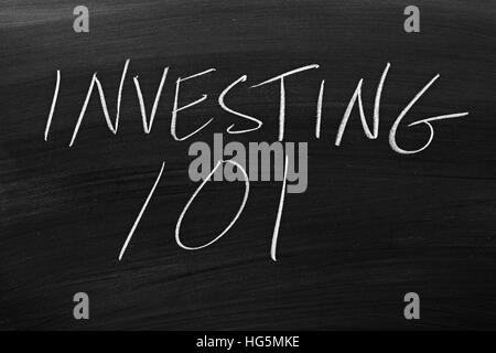 The words 'Investing 101' on a blackboard in chalk - Stock Photo