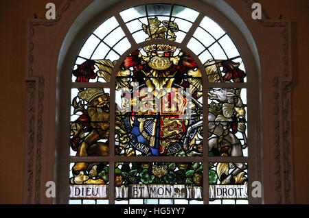 Royal Coat of Arms stained glass window in Belfast City Hall - Stock Photo
