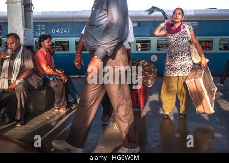 Passengers activity on the platform of Varanasi Junction railway station. Uttar Pradesh, India. - Stock Photo