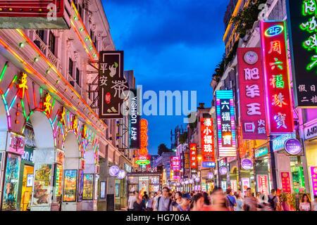 GUANGZHOU, CHINA - MAY 25, 2014: Pedestrians pass through Shangxiajiu Pedestrian Street. The street is the main - Stock Photo