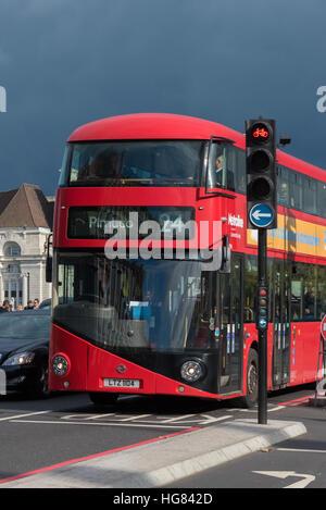 London Bus crossing Westminster Bridge - Stock Photo