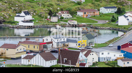 Small village community, Twillingate, Newfoundland.  Fishing boats docked along the shoreline in this coastal town. - Stock Photo