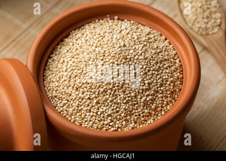 Raw white Quinoa seeds in a jar close up - Stock Photo