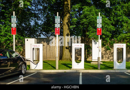 Tesla Supercharger Station on the Merritt Parkway in Greenwich, Conneticut, USA. - Stock Photo