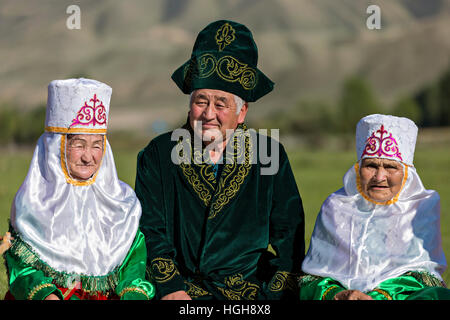 Kazakh man and women in national costumes. - Stock Photo