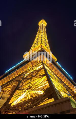 Eiffel tower of Paris Hotel in Las Vegas at night - Stock Photo