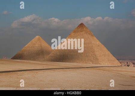 The pyramids of Giza, in southwest part of Cairo, is dominated by the massive pyramids built by 4th dynasty rulers - Stock Photo