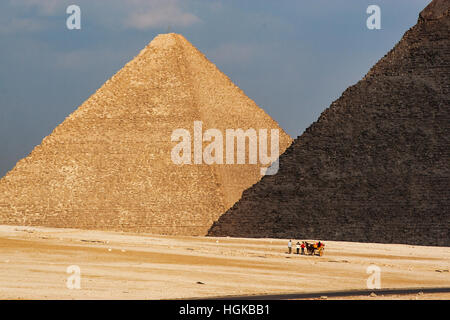 The pyramids of Giza is in southwest part of Cairo is a popular tourist destination. Tours by camel are popular - Stock Photo