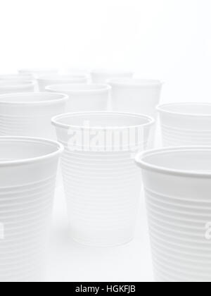 Plastic cups on a white background - Stock Photo