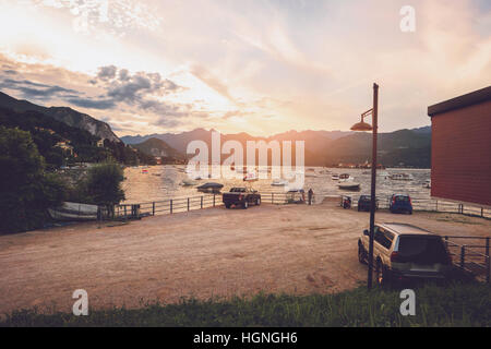 Boats, water and mountains. - Stock Photo
