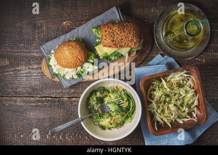 Different healthy snacks  on the wooden table top view - Stock Photo