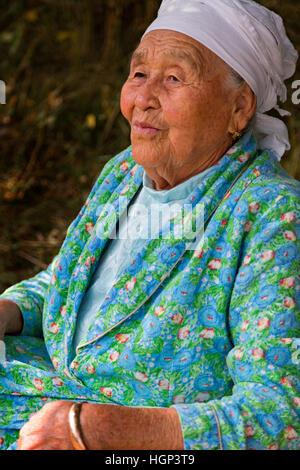 Kazakh elderly lady in Altyn Emel, Kazakhstan - Stock Photo