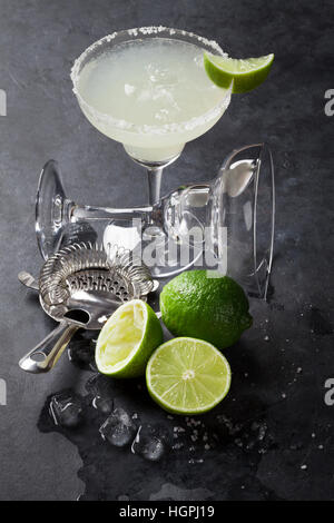 Margarita cocktail on dark stone table - Stock Photo