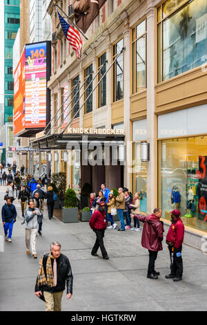 People walking along the sidewalk outside the Knickerbocker Hotel in New York - Stock Photo