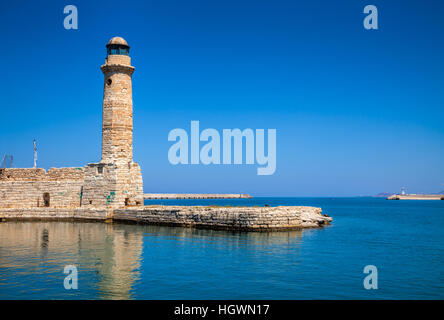 Egyptian lighthouse at Venetian port in Rethymno old town Crete Greece Mediterranean - Stock Photo