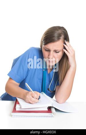 Female doctor studying hard books - Stock Photo