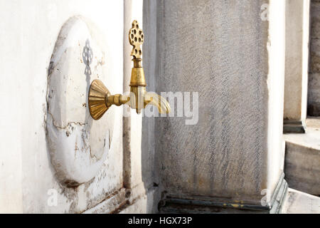 Ablution water tap in a mosque in Istanbul - Stock Photo