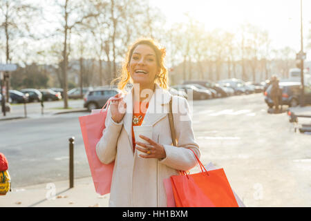 Paris, Attractive woman walking in the street - Stock Photo