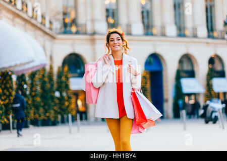 Woman doing shopping in Paris, Place Vendome - Stock Photo
