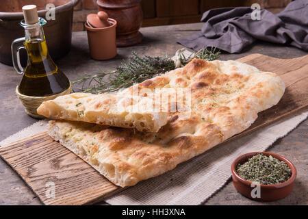 Focaccia romana's bread on rusti still life composition - Stock Photo