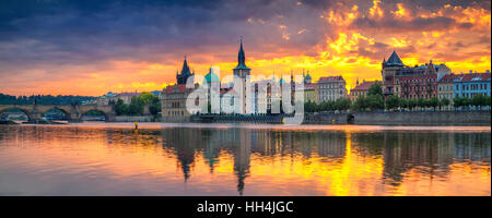 Prague. Panoramic image of Prague riverside and Charles Bridge, with reflection of the city in Vltava River. - Stock Photo