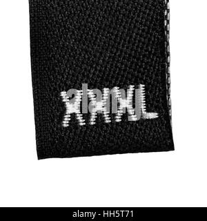 XXXL size clothing label tag, black fabric, isolated on white, detailed macro closeup - Stock Photo
