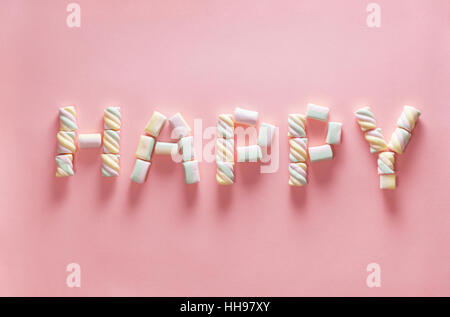 Letter HAPPY from marshmallow on gentle pink background. Flat lay. Image for valentine day concept - Stock Photo