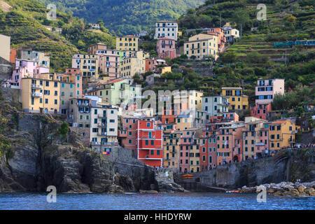 Tiny harbour and medieval houses in steep ravine, Riomaggiore, Cinque Terre, UNESCO, Ligurian Riviera, Liguria, - Stock Photo