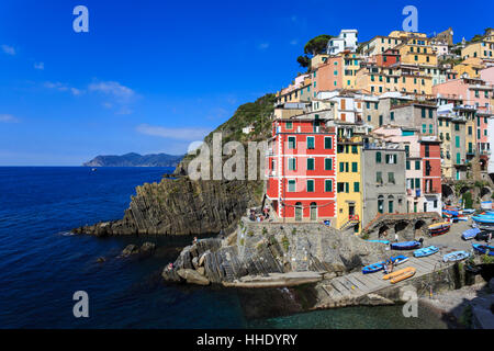 Tiny harbour and medieval houses in steep ravine, Riomaggiore, Cinque Terre, UNESCO, Ligurian Riviera, Liguria, - Stock Photo