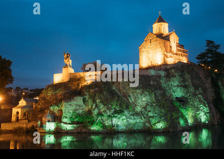 Night Evening Illuminated View Of The Metekhi Church And The Equestrian Statue Of King Vakhtang Gorgasali On The - Stock Photo