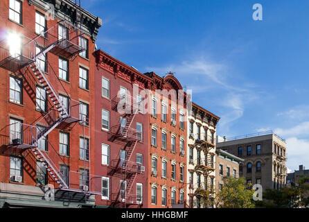 Historic Apartment Buildings along Bleecker Street in the Greenwich Village neighborhood of Manhattan, New York - Stock Photo