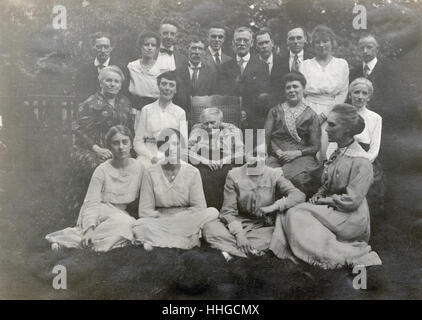 Antique c1910 photograph of an older family group, with the elderly matriarch seated in the center. SOURCE: ORIGINAL - Stock Photo