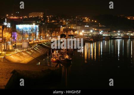 Riverside of Vila Nova de Gaia (Portugal) at night - Stock Photo