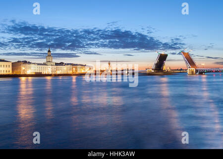 The raised Palace bridge at white nights in the city of St.-Petersburg - Stock Photo